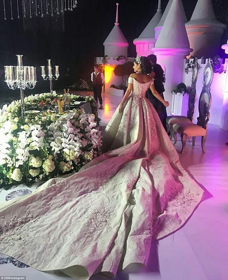 The ceremony, held at the Uzekspocentre Exhibition Centre, was decorated with hundreds of fragrant blooms as well as a miniature fairytale castle for the brides special day
