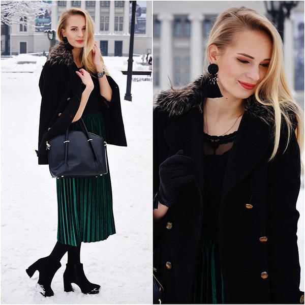 Tông xanh ngọc trở nên bắt mắt hơn khi được phối hợp trên chất liệu vải có khả năng bắt sáng cao. Đi cùng váy midi dập ly là áo khoác măng tô, bốt và túi đồng điệu tông đen.