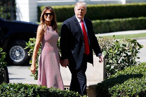 Vợ chồng tổng thống Mỹ Donald Trump. Ảnh: AP.