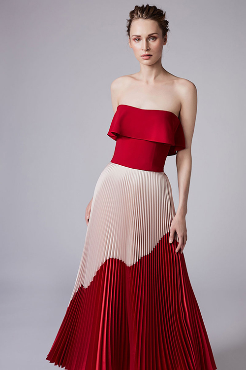 4. Váy hai màu: Mẫu váy này có sự kết hợp ngẫu hứng giữa hai tôngtrắng - đỏ. Cô dâu sẽ thật nổi bật khi diện mẫu váy này của Reem Acra tại bàn tiếp tân. Thêm vào đó, lớp vải bồng trên ngực sẽ giúp cô dâu có vòng 1 nhỏ nhắn che đi khuyết điểm.