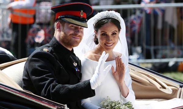 Hoàng tử Harry và vợ Meghan Markle trong ngày cưới. Ảnh: PA.