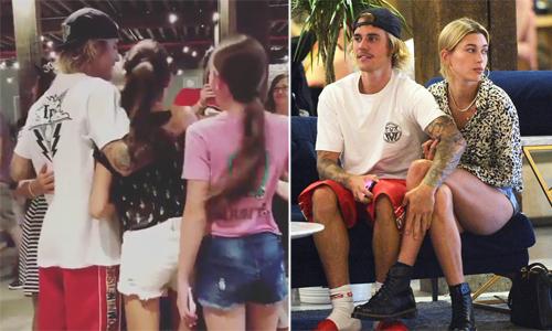 Justin Bieber ôm fan nữ chụp ảnh dù đang ở bên người yêu