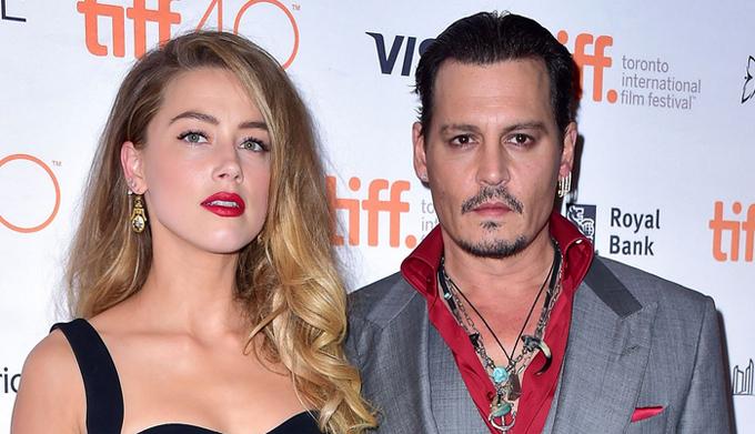 Johnny và Amber Heard ly hôn sau hơn một năm chung sống.