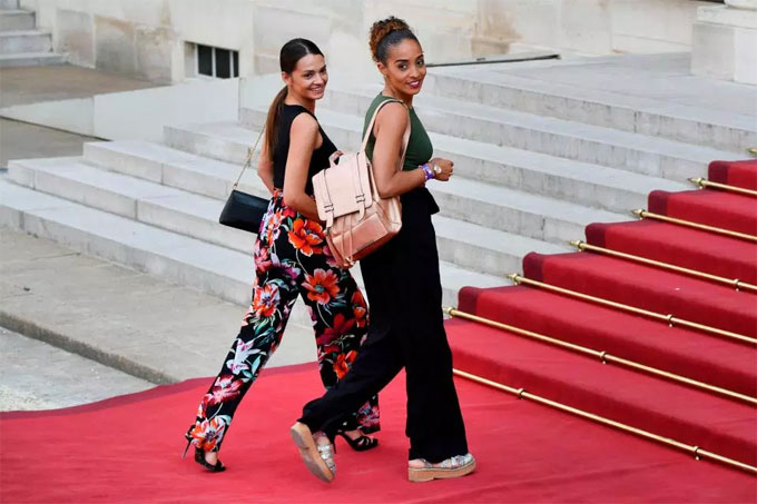 Midfielder Corentin Tolissos girlfriend Sarah and sister Marine strutted down the red carpet togetherThey will be greeted by up to 3,000 guests at the reception, including 1,000 young footballers from local clubs including Bondy, where Kylian Mbappe first began his career.