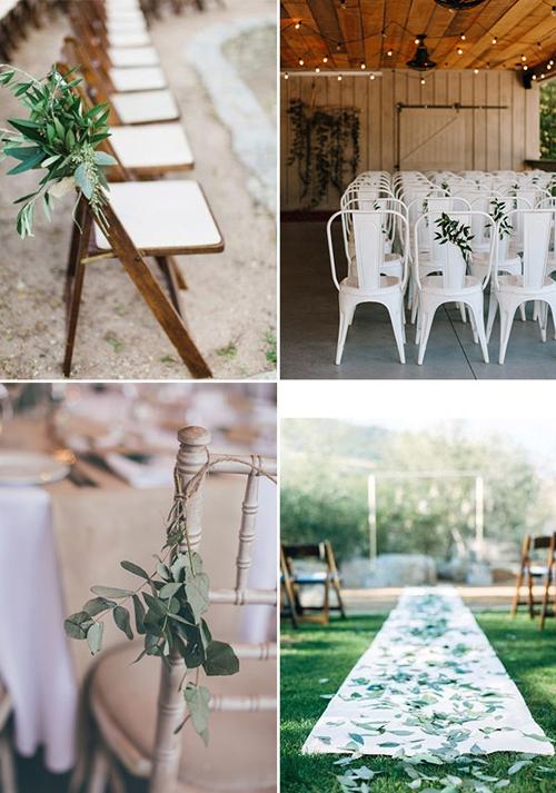 Với xu hướng minimalist, hoa tươi được tinh giản, lá cây được gắn vào ghế ngồi hoặc trải dọc lễ đường tạo hiệu ứng thị giác.