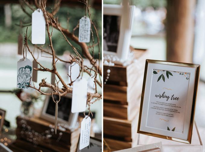 Đôi vợ chồng làmcây điều ước (dự án DIY) để mang vào hôn lễ. Họ cắt những tấm thẻ trắng, đặt chúng ở bàn tiếp tân để khách mời viết lên một điều ước. Sau đó khách mời có thể tự buộc tấm thẻ lên cây điều ước.