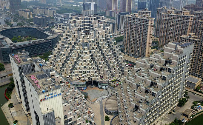 Standing 100 metres tall, the bizarre yet popular building is a part of a residential and commercial complex