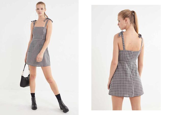 Váy hai dây kiểu dáng thắt nơ mang đặc trưng của phong cách sexy. Nhưng bạn gái vẫn có thể sử dụng nó để đến văn phòng khi mix cùng các kiểu áo thun dài tay, sơ mi hay áo blouse.