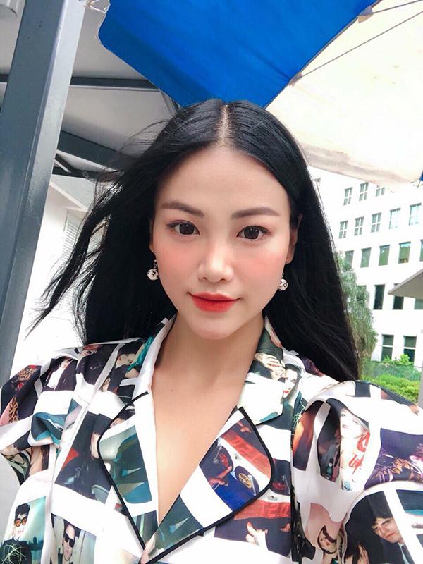 Phong cách thời trang sành điệu của hoa hậu trái đất Phương Khanh - 2