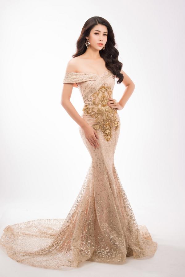 Đối thủ của Hoa hậu Phương Khánh diện váy ôm khoe vóc dáng - 2