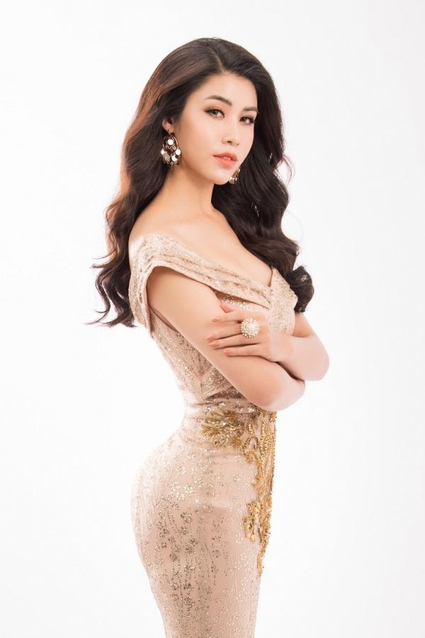 Đối thủ của Hoa hậu Phương Khánh diện váy ôm khoe vóc dáng - 3
