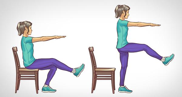 Ngồi trên ghế với một chân duỗi thẳng, hai tay đưa thẳng phía trước ngực, nâng người lên