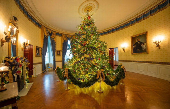 The White House expects to host 100 open houses and more than 30,000 guests who will tour the festive displays