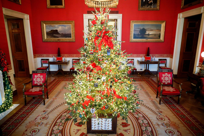 The Red Room is seen decked out for Christmas, with the bright decorations complimenting the colour of the surroundings