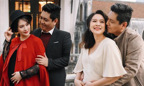 Thanh Thúy bế bầu 7 tháng cùng chồng dạo phố Hà Nội