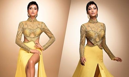 H'Hen Niê mang đầm dạ hội phối áo dài đến Miss Universe