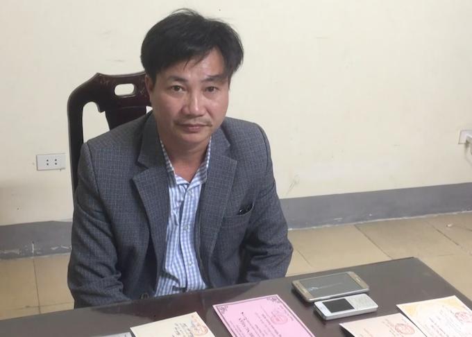 Nghi can Nguyễn Kim Hồng lúc bị bắt. Ảnh: Anh Thư.