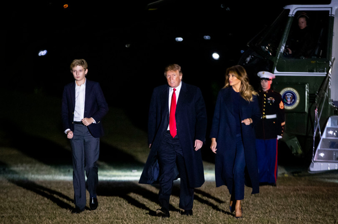 President Donald Trump, first lady Melania Trump and son Barron Trump arrive aboard Marine One on the South Lawn of the White House February 3, 2019 in Washington, D.C. Trump was returning from a weekend at his Mar-a-Lago club in Florida.