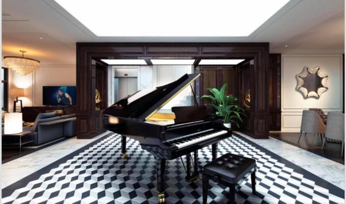 Đàn piano làm điểm nhấn trước thang máy và khu vực bếp.