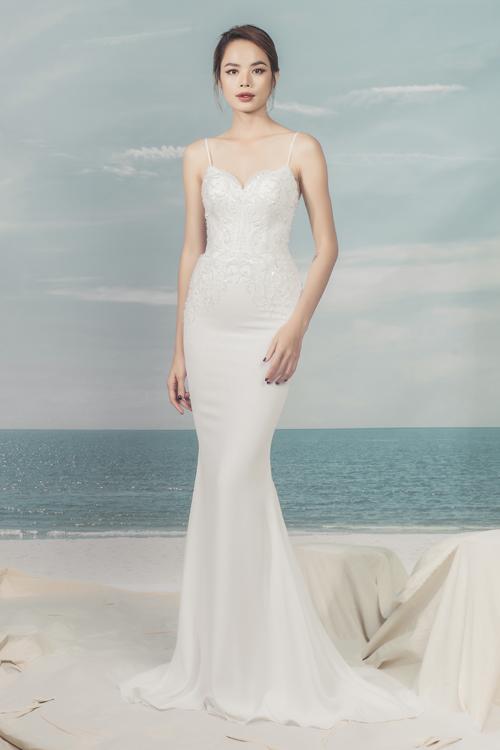 Xu hướng váy cưới hiện đại dần chuyển dịch tới các thiết kế tối giản hơn. Hình ảnhváy cưới với tùng váy lớn gây vướng víu đã dần nhường chỗ cho sự thanh lịch mà sang trọng.