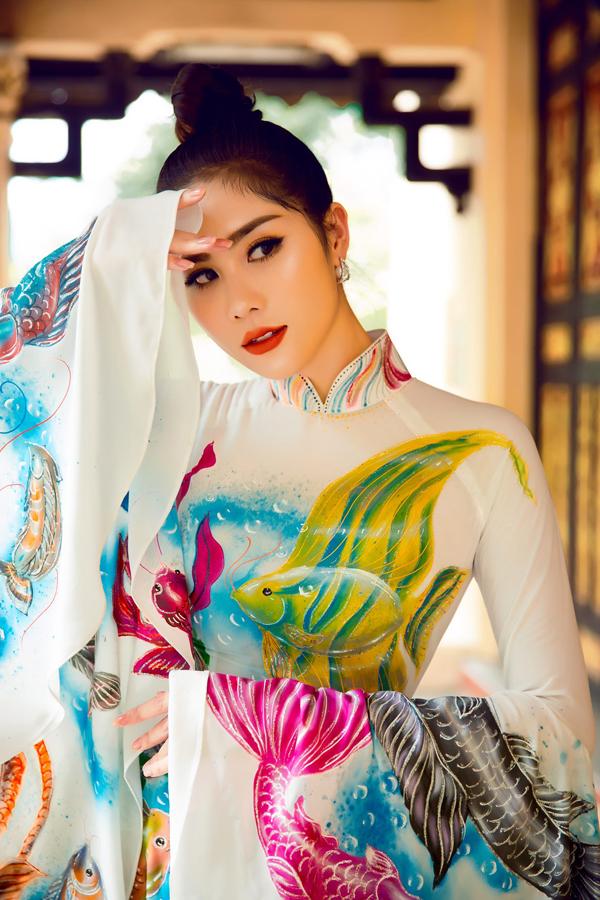 Á hậu Hoàng Hạnh diện áo dài lấy cảm hứng từ đại dương - 4