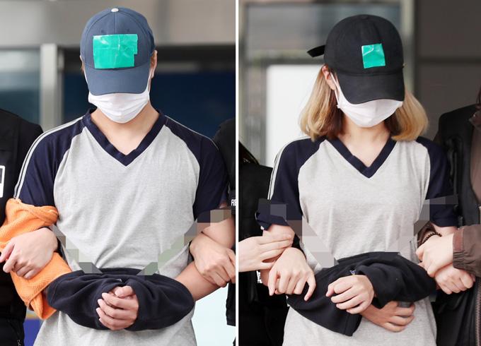 Cặp vợ chồng đội mũ, đeo khẩu trang kín mít khi bị bắt. Ảnh: Yonhap.