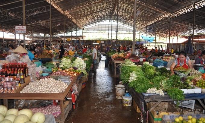 Một chợ địa phương ở Viêng Chăn- Ảnh The Guardian