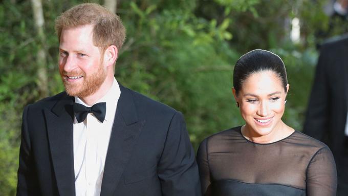 Vợ chồng Harry - Meghan ở lễ ra mắt phim Vua sư tử tại châu Âu hôm 14/7. Ảnh: PA.