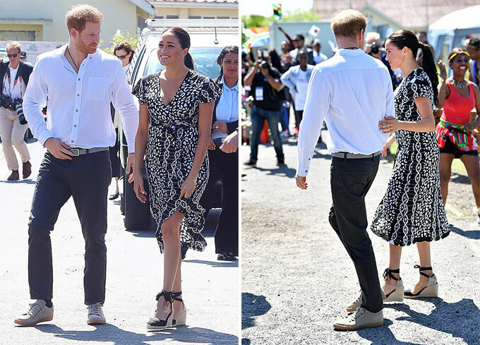 Adorable moment a shy young schoolboy gives Meghan Markle a huge hug as she and Prince Harry tour township dubbed South Africas murder capital while baby Archie stays behind with a nanny amid super-tight security - 8