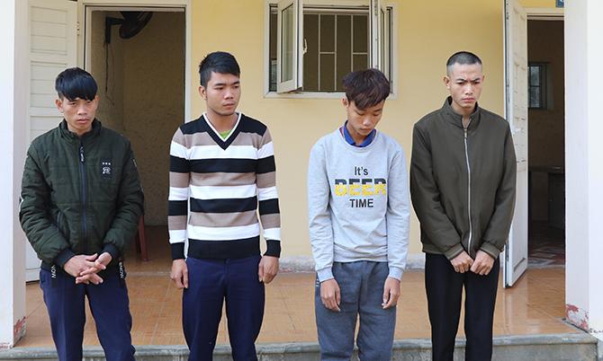 Bốn nghi can Tiến Dũng, Hiên, Hiếu và Trung Dũng (từ trái qua) tại cơ quan điều tra. Ảnh: C.A