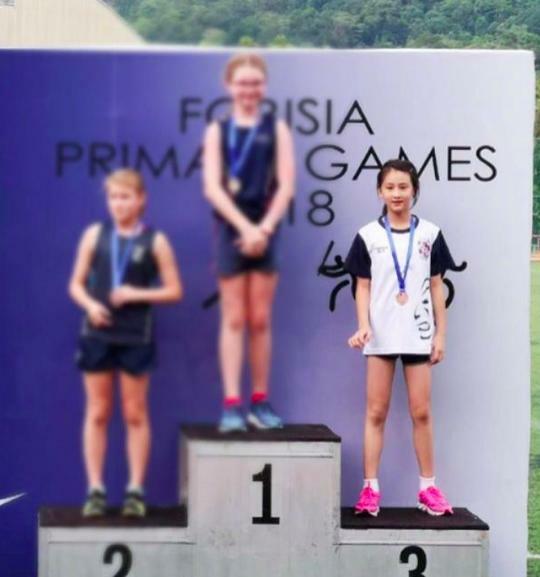 Điền Vũ Tranh trong một cuộc thi chạy.