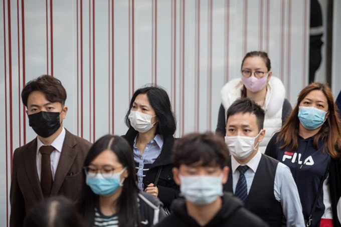 Các công ty Trung Quốc khuyến khích nhân viên làm việc từ xa ở nhà thay vì đến công ty. Ảnh: Bloomberg.