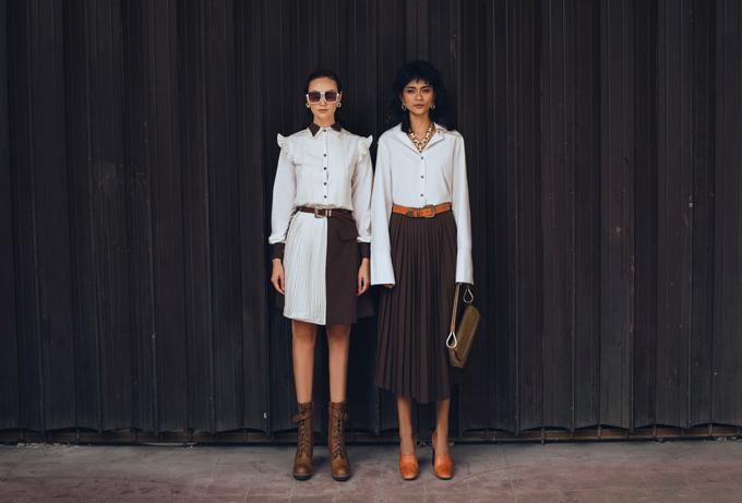 Sơ mi, áo blouse trắng được cách điệu nhẹ nhàng có thể kết hợp cùng các kiểu chân váy midi, váy dập ly, váy chữ A phối màu tương phản.