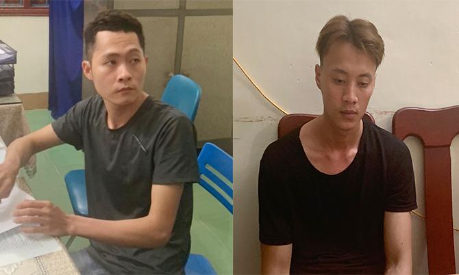 Nguyễn Thái Thành và Võ Hồng Quang tại cơ quan công an. Ảnh: Đại Hiệp.