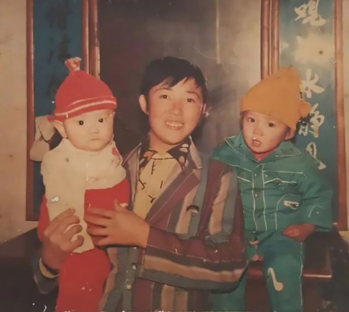 Zhange Wei (left) was kidnapped while he was asleep with his two-year-old sisterCredit: AsiaWire