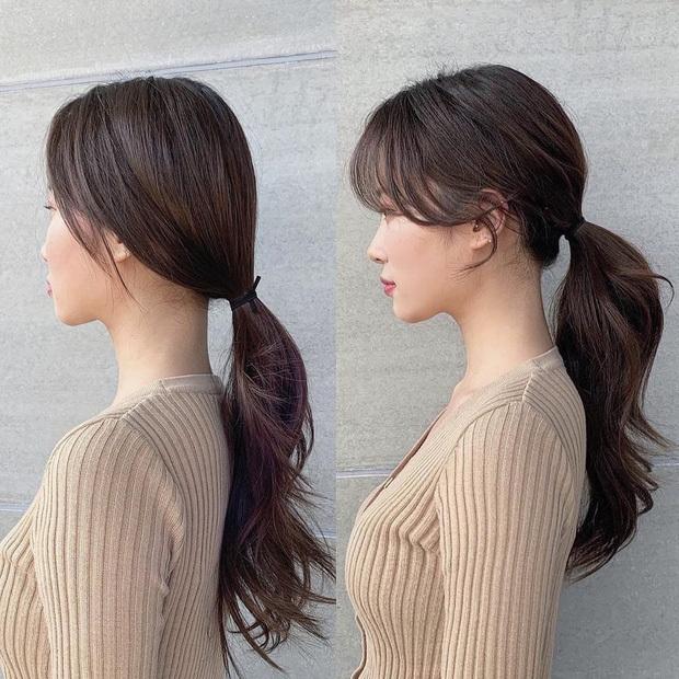 Không nên buộc tóc quá thấp, sát vào phần gáy mà nên nâng cao trên gáy để tóc có độ phồng.