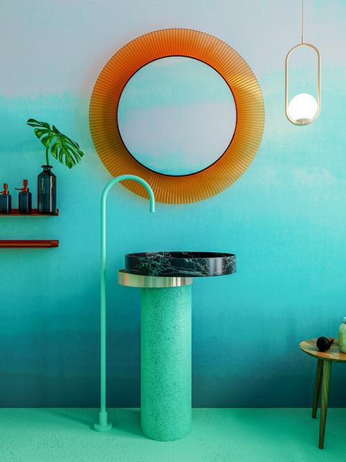 Khu vực phòng vệ sinh như tái hiện cảnh quan của vùng biển nhiệt đới với lá cọ, tường ombre mô phỏng bầu trời xanh.
