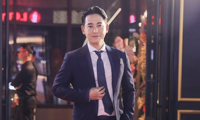 Diễn viên Hứa Vĩ Văn tại buổi chiếu ra mắt phim Tiệc trăng máu ở Hà Nội.