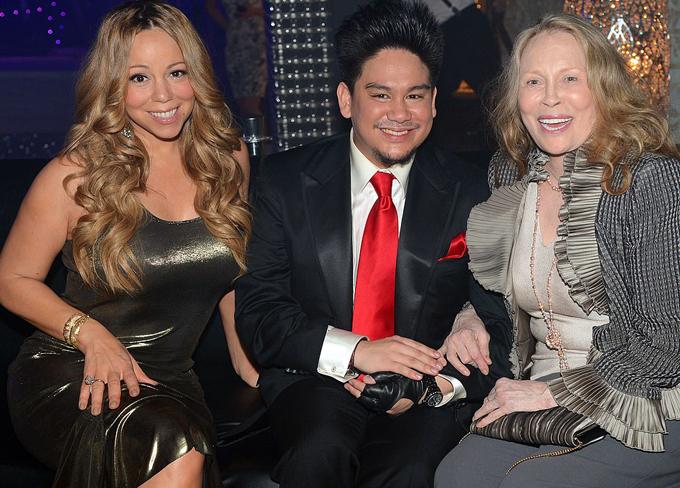 Hoàng tử Brunei chụp cùng Mariah Carey và ngôi sao Faye Dunaway. Ảnh: Rex.
