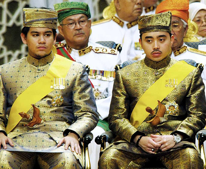 Prince Azim (left) with one of his brothers in 2004 at the Nurul Iman royal palace - the official residence of the Sultan of Brune