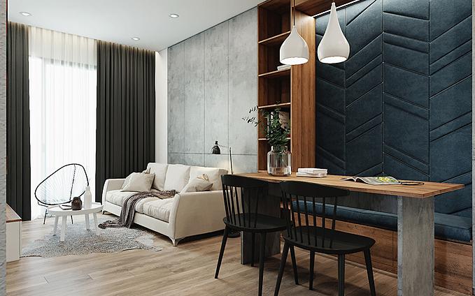 Nhằm tạo điểm nhấn và hướng mọi người đến không gian sinh hoạt chung, KTS đã dùng chất liệu nỉ màu xanh ghi bọc lên một phần mặt tủ và ghế ngồi. Phần tủ gỗ công nghiệp ở phòng khách được phủ bề mặt dạng bê tông, giống như một mảng tường màu xám gợi lên sự thô mộc.
